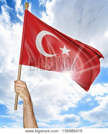 Person's hand holding the Turkish national flag and waving it in the sky, 3D rendering
