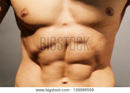 Torso of a well defined men's abdomen