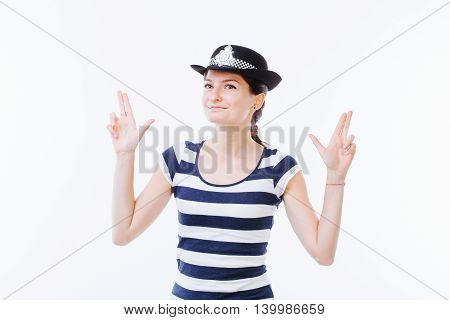 Young smiling woman acting as a police officer - isolated on white