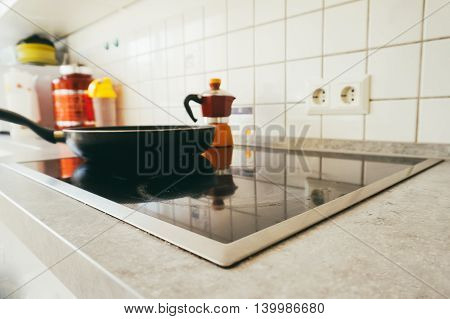 Modern kitchen with steel pot on the induction cooker