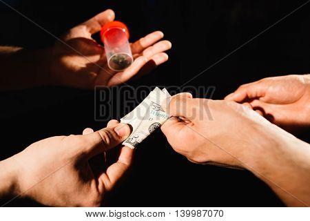 Closeup of drug dealer taking money for cocaine