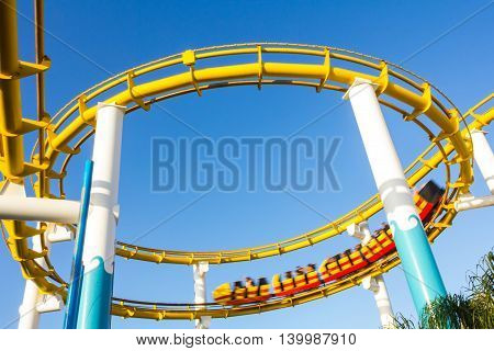 Los Angeles CA USA - July 6 2013: Moving roller coaster at Pacific Park near Santa Monica peer.