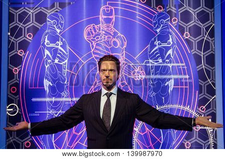Los Angeles CA USA - July 6 2013: Madame Tussaud's Hollywood figures - Robert Downey Junior. On background Iron man drawings.