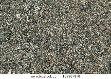 Small hoggin stones texture top view close shot abstract background