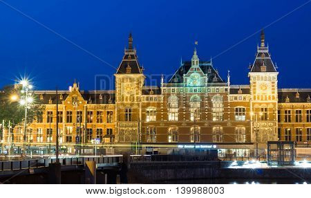 The Central station in the evening Amsterdam Netherlands.