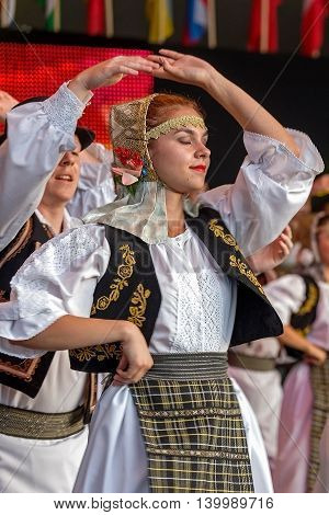 "ROMANIA TIMISOARA - JULY 7 2016: Young Romanian dancers in traditional costume perform folk dance during ""International Festival of hearts"" organized by the City Hall Timisoara."