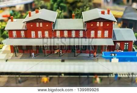 City In Miniature. Model Of Railstation With Passengers.
