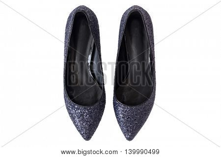Top view of new pair of sparkling stylish navy blue high heels, beautiful shoes with glitters for ladies isolated on white background