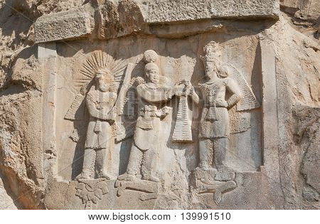 Persian kings on stone relief of the monument Taq-e Bostan in Iran. Taq-e Bostan is rock relief from 4 century era of Sassanid Empire of Persia