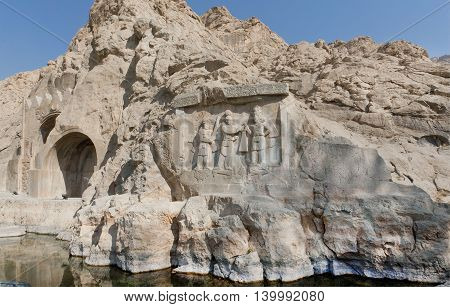 Lake around the ancient relief in Kermanshah - Crowning ceremony of Ardashir II. Stone monument Taq-e Bostan in Iran. Taq-e Bostan is rock relief from 4 century era of Sassanid Empire of Persia