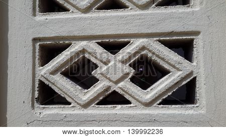 white,painted, concrete block with diamond pattern, seen in a temple gate, Songkhla, Thailand