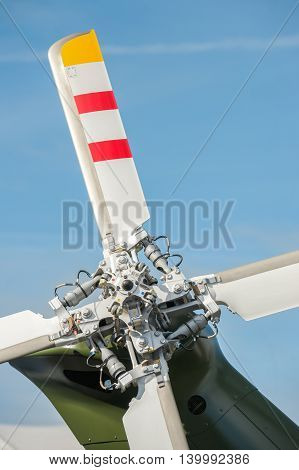 close-up of helicopter tail rotor blades against blue sky