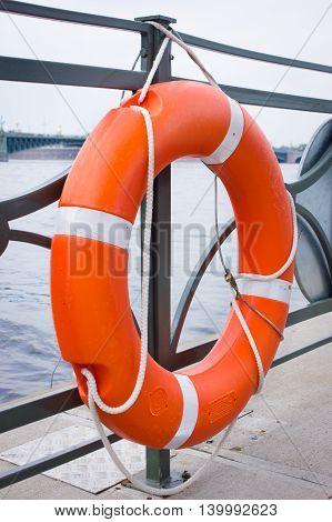 Orange lifebuoy of fast safety. Safety concept.