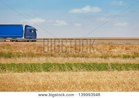 Blue heavy truck on the road. Delivery cargo logistic. Horizontal
