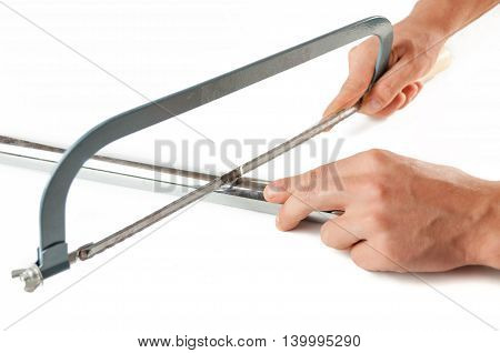 Men's Hands Cut A Metal Pipe Hand Saw