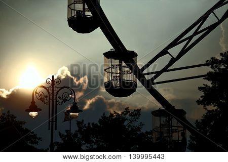 part of ferris wheel against the evening sky