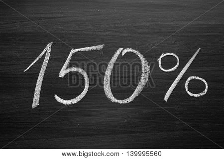 150 percent header written with a chalk on the blackboard