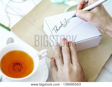 Unwrapped Present Writing Thank you Message Concept