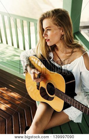 Woman Sitting Playing Guitar Outdoors Concept