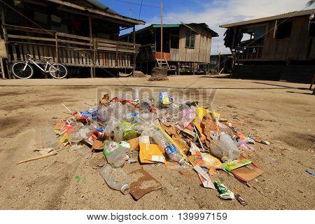 MABUL, MALAYSIA - CIRCA JULY 2016: Plastic garbage pollution in poor Asian village.