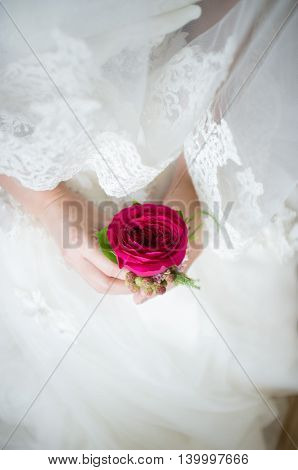 Rose corsage for groom from the bride