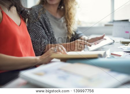 Women Friends Talking Using Tablet Concept