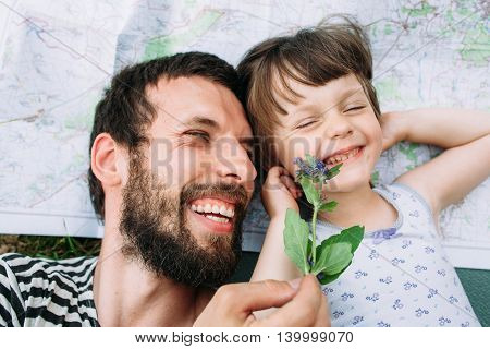 Happy family, father and daughter have fun at travel. Enjoying pastime together