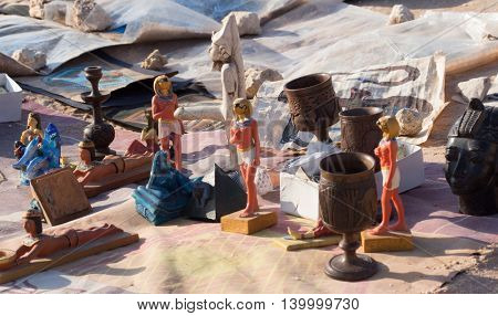 EGYPT, SHARM EL-SHEIKH - JULY 26, 2015: Bedouin Egyptian sells souvenirs on the beach