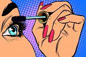 Makeup. Eyeliner. Make-up Applying closeup. Cosmetic Eyeshadows. Eyeline brush  pop art retro vector poster