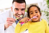 Pediatrician learn cute african girl brushing tooth healthy concept poster