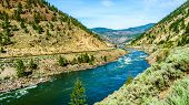 Thompson River with its many rapids flowing through the Canyon in the Coastal Mountain Ranges of British Columbia, Canada poster