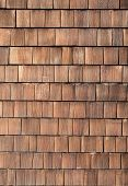 Wood tiles close up dark brown background. poster