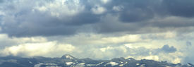 Cloudy, Snowy mountain landscape panorama