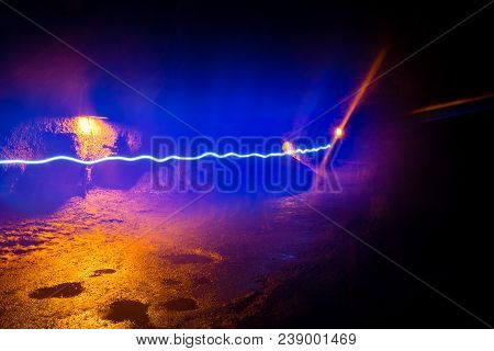 Light Trail From A Hiker With A Flashlight Inside The Thurston Lava Tube In Hawaii Volcanoes Nationa