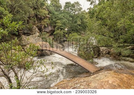 A Pedestrian Bridge On The Trail To The Cascades In The Mahai River In The Kwazulu-natal Drakensberg