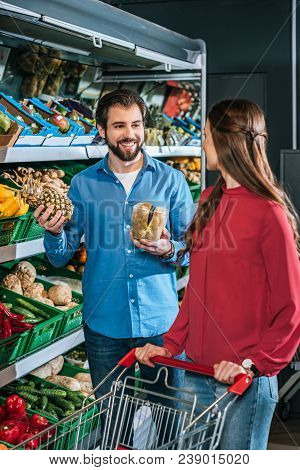 Couple With Shopping Cart With Shopping Together In Supermarket