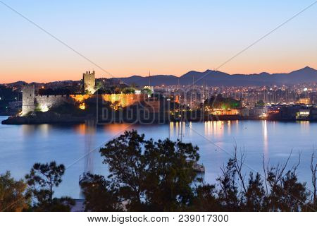 BODRUM, TURKEY - APRIL 11, 2014: Night view to the St. Peter's castle and cityscape. Built in XV century, now the castle housed the Museum of Underground Archaeology