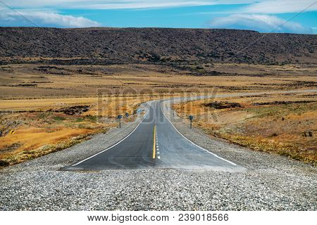 End of the asphalt road named Ruta 40 in Argentinian Patagonia. Asphalt road turns into gravel road on National road Ruta 40, Argentina.