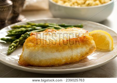 Delicious Pan Seared Halibut With Asparagus And Wild Rice.