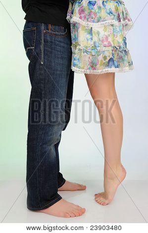 Legs Of Beautiful Couple Kissing. Studio Shot