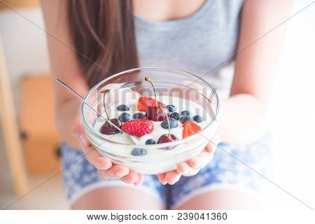 Closeup Yogurt With Berries Fruit In Bowl On Woman Hands