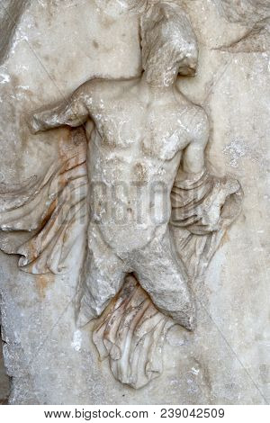 Damaged marble antique high-relief at Mausoleum at Halicarnassus in Bodrum, Turkey