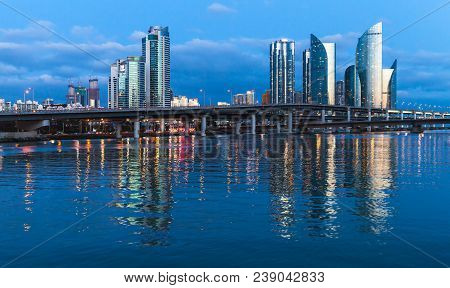 Marine City At Night, Panoramic Skyline Of Luxury Skyscrapers And Viaducts. Expensive And Prestigiou