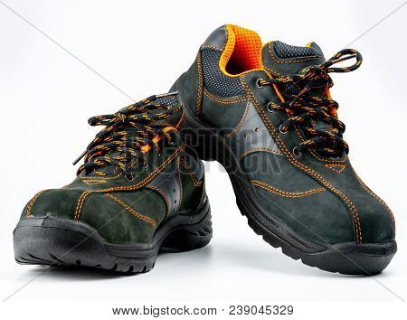 Pair Of Black Safety Leather Shoes Isolated On White Background With Copy Space. Work Shoes For Men