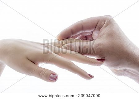 Hand Puts The Ring On The Hand