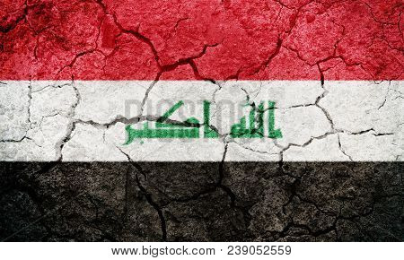 Republic Of Iraq Flag On Dry Earth Ground Texture Background