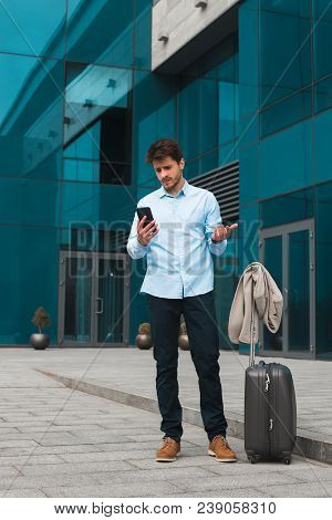 Right Decision Is Coming! Handsome Smart Entrepreneur On Business Trip Abroad Texting Messages From