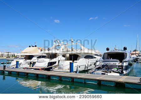 Vilamoura, Portugal - June 6, 2017 - Luxury Boats Moored Against A Pontoon In The Marina, Vilamoura,