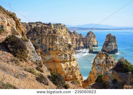 Elevated View Of The Rugged Coastline And Cliffs, Ponta Da Piedade, Algarve, Portugal, Europe.