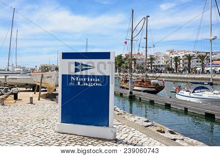 Lagos, Portugal - June 9, 2017 - Marina Sign With Yachts Moored Along The River Bensafrim To The Rea